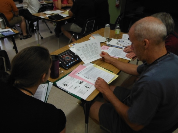 Special Educator Emily Cogan and Science Teacher Tom Pfeiffer  look over materials supplied to the Developmental Assets training group