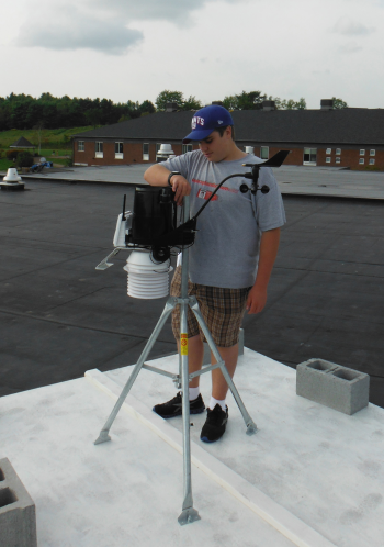 BFA Sophomore Geoff Schukel assists with the rooftop installation.