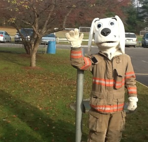 """Sparky"" the Firedog greets the students with a friendly hello!  ""Sparky"" is a former FES student (Brendan Blair)"
