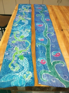 Completed scarves by Mrs. Garland (left) and Gracie B (Grade 9).