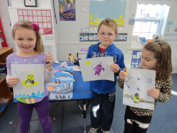 Proud artists display their penguins.