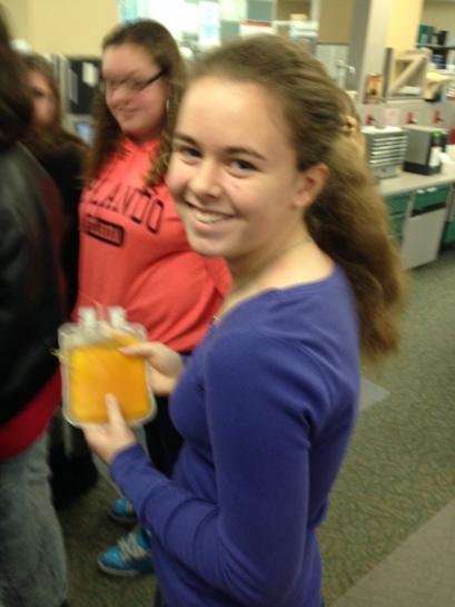 student holds plasma