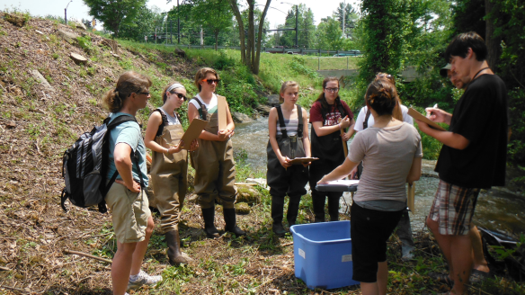 BFA Students Jordan Hoffman and Emily Pomichter work with high school teams from CVU and Long Trail School measuring water velocity as part of summer training 2013 with RACC in Shelburne, VT.