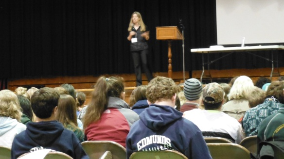 Lauren Traister (4-H Teen & Leadership Program Coordinator from UVM Extension) addresses the 240+ students from all over Vermont at the Youth Environmental Summit at the Barre Civic Center.