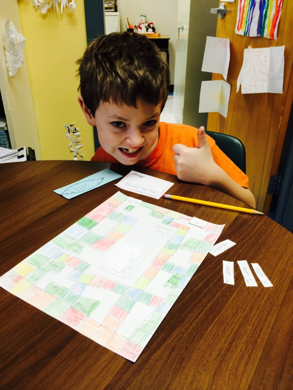 A Fletcher student plays a game he designed around the PBIS behavior system. Modeled after Monopoly, the game takes students through the steps of positive behavior. (The Principal lost to the student while playing the game!!!)