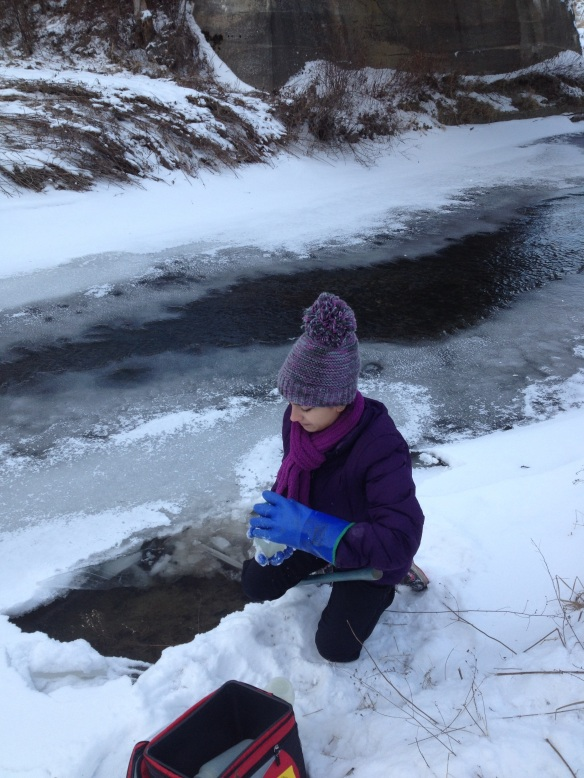 BFA HS student Rebekah Larose collects water samples at Black Creek in East Fairfield, VT