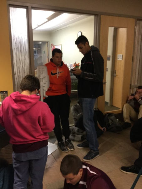 BFA HS students, left to right Lana Goodrich, Chris Campbell, David Legris (seated), Binny Singh, Hudson Elledge (behind) and Zach Minor wait in line at 6am at UVM on October 1st for tickets to Al Gore's talk.