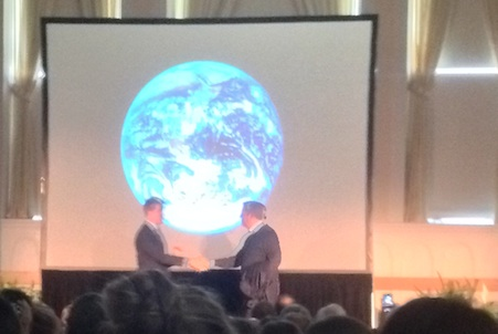 Seventh Generation CEO John Replogle and Al Gore former Vice President greet each other in front of a picture of the earth from space at Ira Allen Chapel UVM campus.