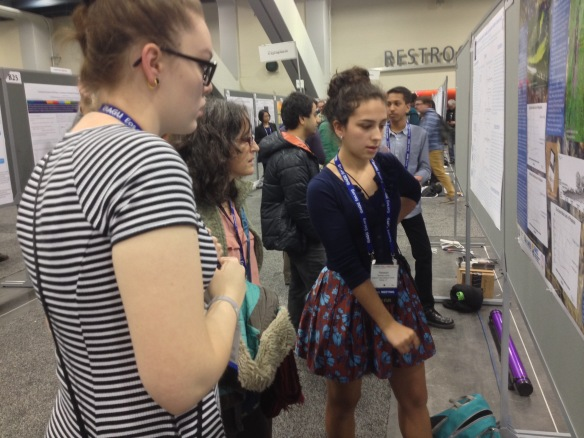 Sophie Lee  (left) and Rebekah Larose explain their research to Dr. Sue Natali, (Woods Hole Research Center) at AGU Fall Meeting, San Francisco, CA.