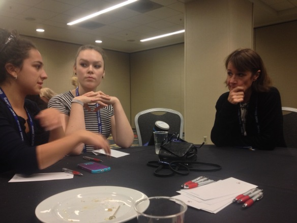 Left to right, Rebekah Larose and Sophie Lee describe their research to the President of the American Geophysical Union, Geophysicist Carol Finn at a luncheon for student researchers.
