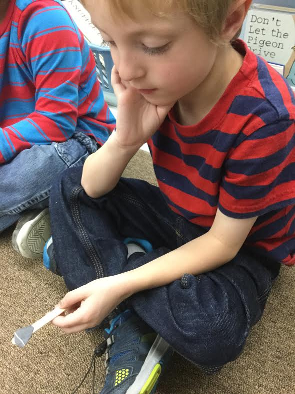 The brain's ability to focus on the present improves with practice. Balancing a rock on a stick requires mindfulness!