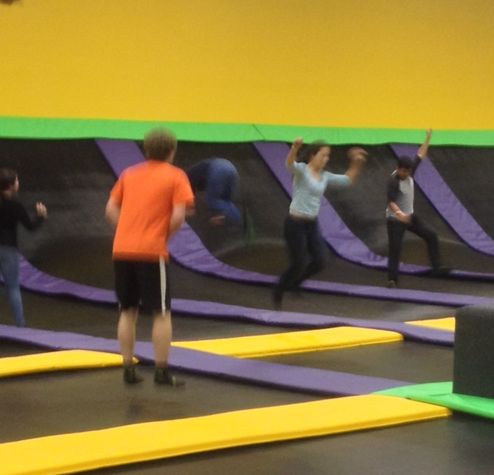 (BFA senior Alex Ferguson and Puerto Rican students Jose and Shanick jump on the trampolines at AirDrop in Williston, VT.)
