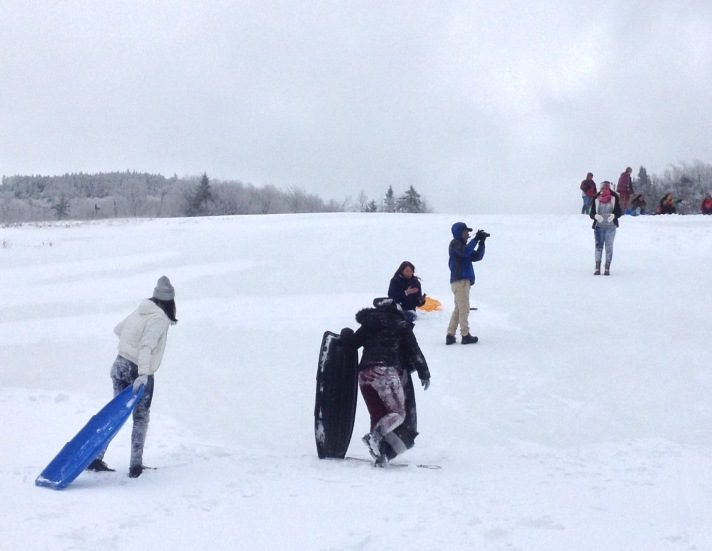 (Puerto Rican students, teachers, BFA-Fairfax students and students from Hartford HS enjoy sledding at Bolton Valley. For the Puerto Rican students this was their first experience with snow!)