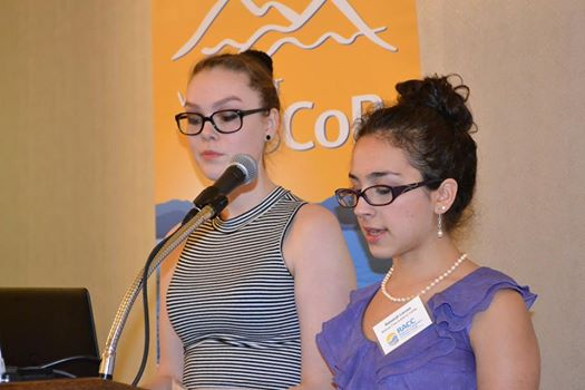 (Sophie Lee and Rebekah Larose speak at the Hilton in Burlington, VT about their research.)