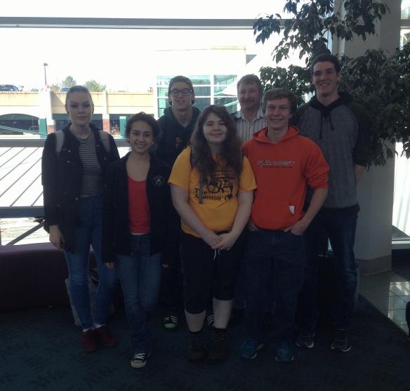 (BFA HS students left to right Sophie L, Rebekah L, Bastien T, Rebecca C, Tom Lane (Tchr.), Alex F, David L leaving Burlington Airport for Puerto Rico.)