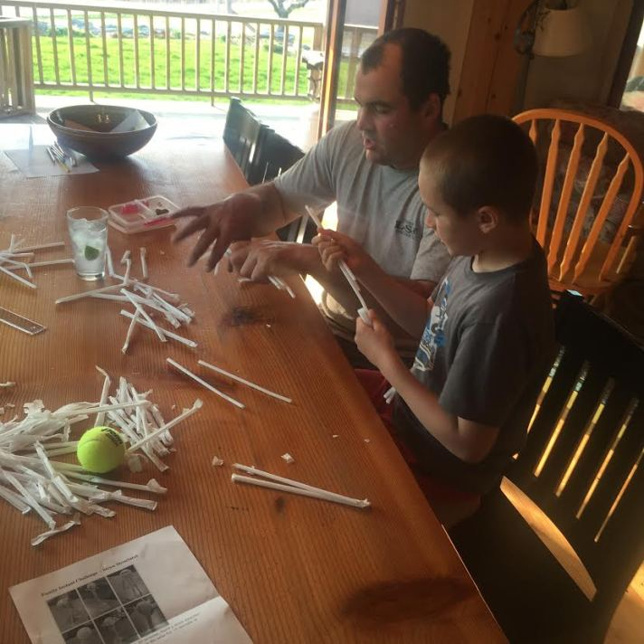 Third grader Magnus Riggs and his dad, Tucker, complete a home engineering challenge together over the weekend.
