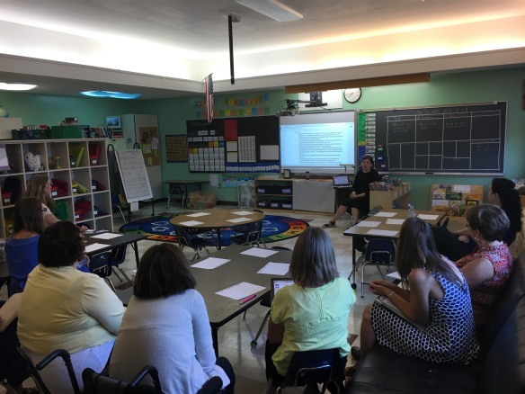 Juliet King discussing FWSU literacy progress monitoring with the K-2 team.