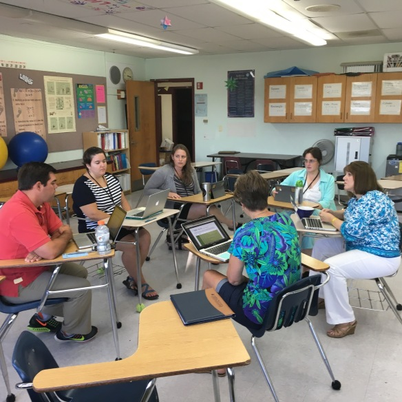 Karen Shearer with the 7th grade team discussing personalized learning plans.