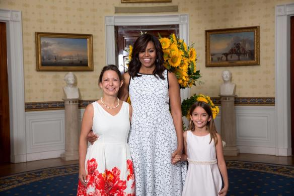 First Lady Michelle Obama greets 2016 Healthy Lunchtime Challenge winner Miranda Gallagher and mother Genevieve Gallagher from Fairfax, Vt., in the Blue Room prior to the Kids' State Dinner in the East Room of the White House, July 14, 2016. (Official White House Photo by Amanda Lucidon)This photograph is provided by THE WHITE HOUSE as a courtesy and may be printed by the subject(s) in the photograph for personal use only. The photograph may not be manipulated in any way and may not otherwise be reproduced, disseminated or broadcast, without the written permission of the White House Photo Office. This photograph may not be used in any commercial or political materials, advertisements, emails, products, promotions that in any way suggests approval or endorsement of the President, the First Family, or the White House.