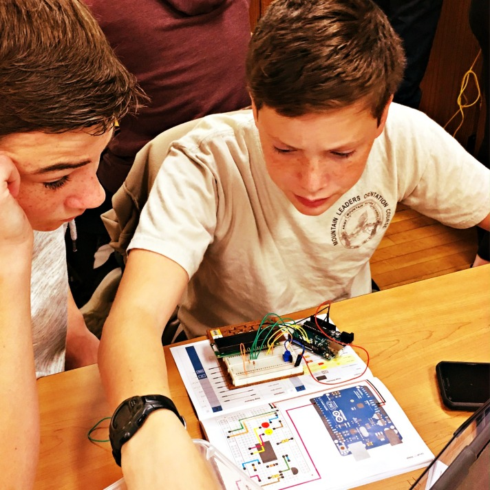 students solving problems with coding