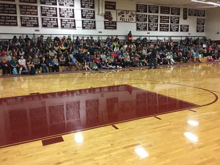 BFA Fairfax High School students listen to Darryl Rodgers during assembly.