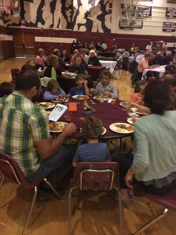 Families enjoying the Harvest Dinner.