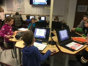 Students collaborate in the Innovation Lab to record voiceover for their writing.