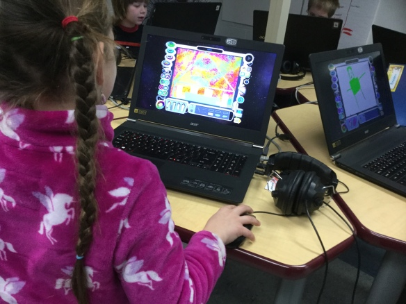 A student creating with KidPix in the Innovation Lab.