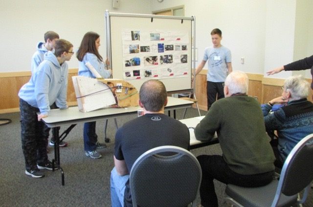 The team presents their design to the panel at the UVM Aiken Maker Challenge.