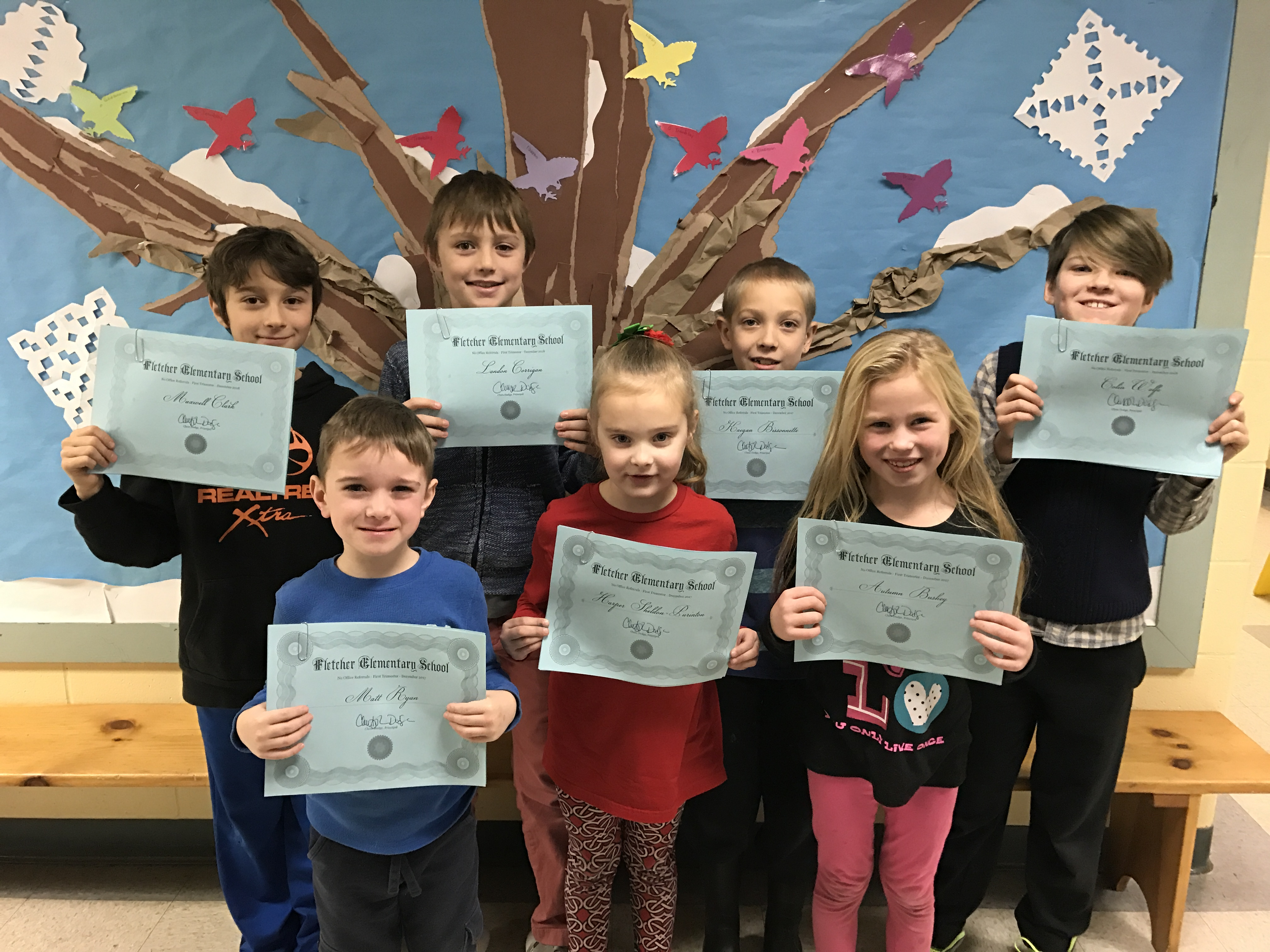 Fifty-eight Fletcher students celebrated having no office referrals during the first trimester this year. The school's trademark blue certificates marked the occasion. Here, one student from each class represents the larger group.