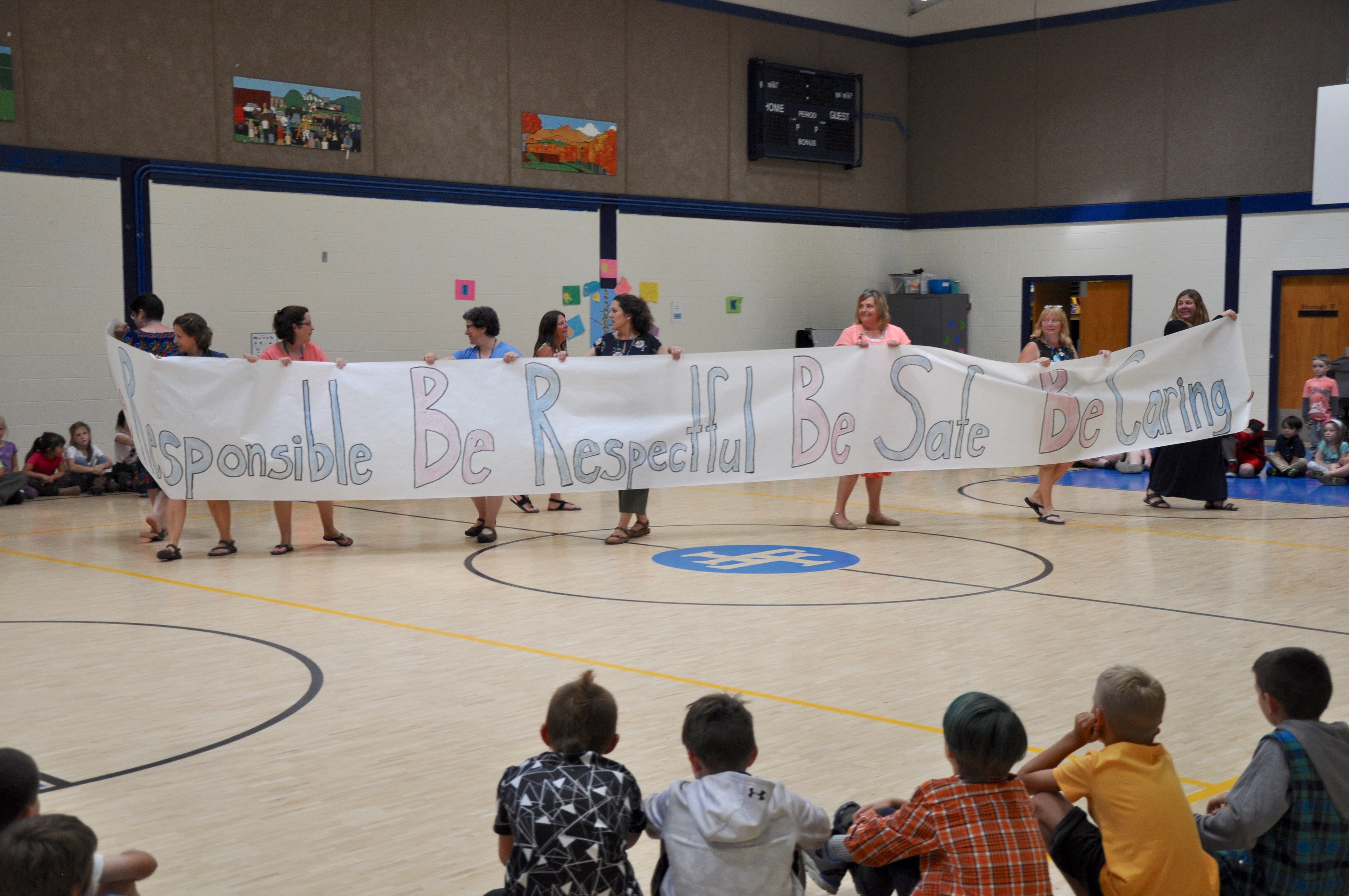 Fletcher students and staff review the school-wide expectations at a whole-school celebration.