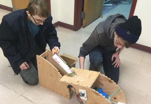 The team works on the prototype of their design.