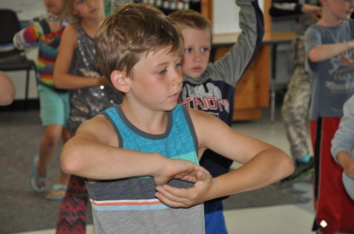 A Fletcher student practices Yoga as part of a classroom celebration of positive behavior.