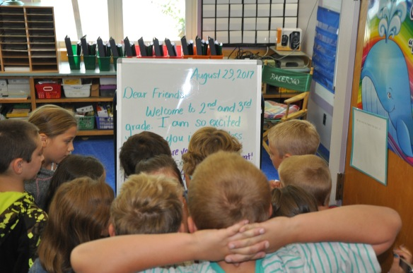 Students read a Morning Meeting greeting.