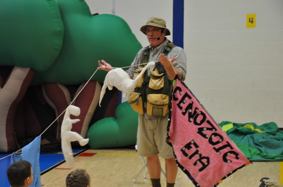 Dinoman, a.k.a. Warren, VT-resident Bob Lisaius, uses a clothesline and stuffed animals to teach Fletcher students about the Mesozoic Era and the creatures that lived at that time.