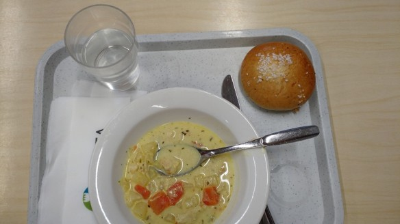 Finnish school lunch - curry chicken and a sweet bun