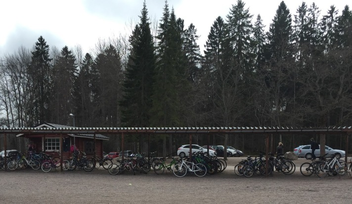 Bikes lined up outside of school even though the snow has barely melted and the temperature is a cool 40 degrees