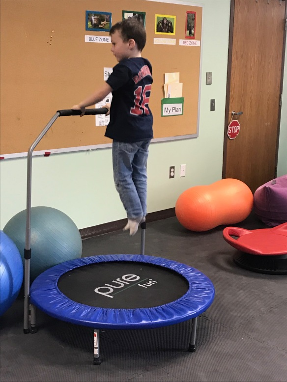 a student uses the mini trampoline on a brain break