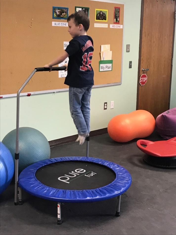 a student uses the mini trampoline on a brain break