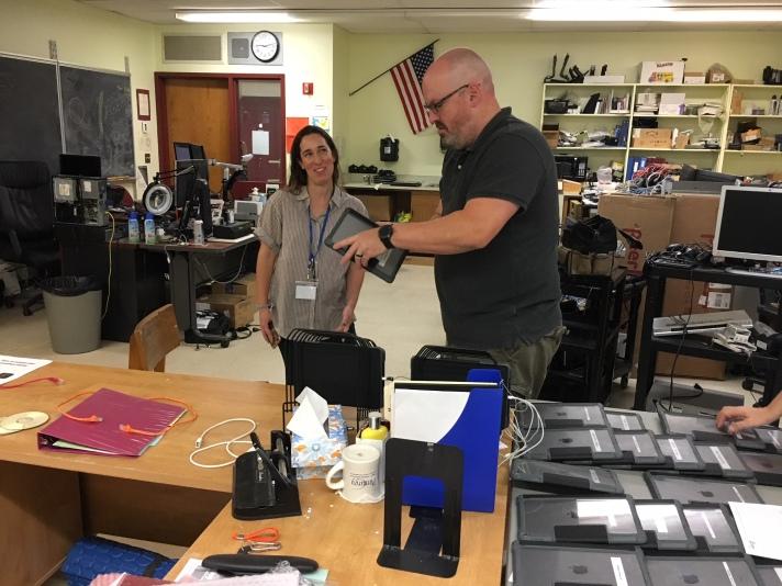FWSU IT Technician Jason Smith assists an employee with a 1:1 Apple iPad device