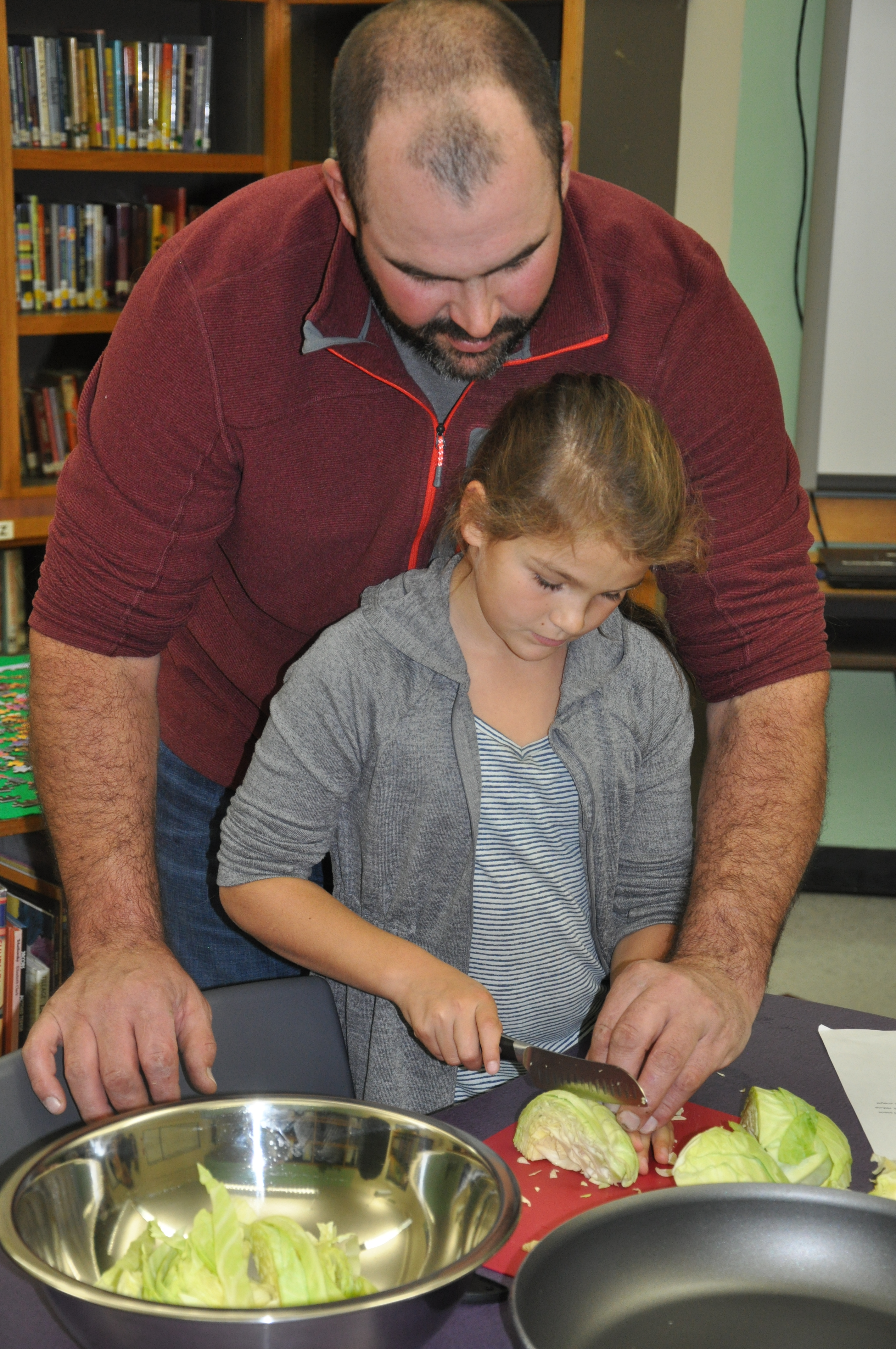 Fletcher Elementary student processes cabbage as part of a cooking class