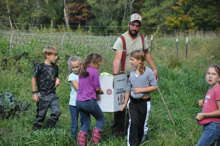 Students bringing in the harvest at West Farm in Jeffersonville, VT