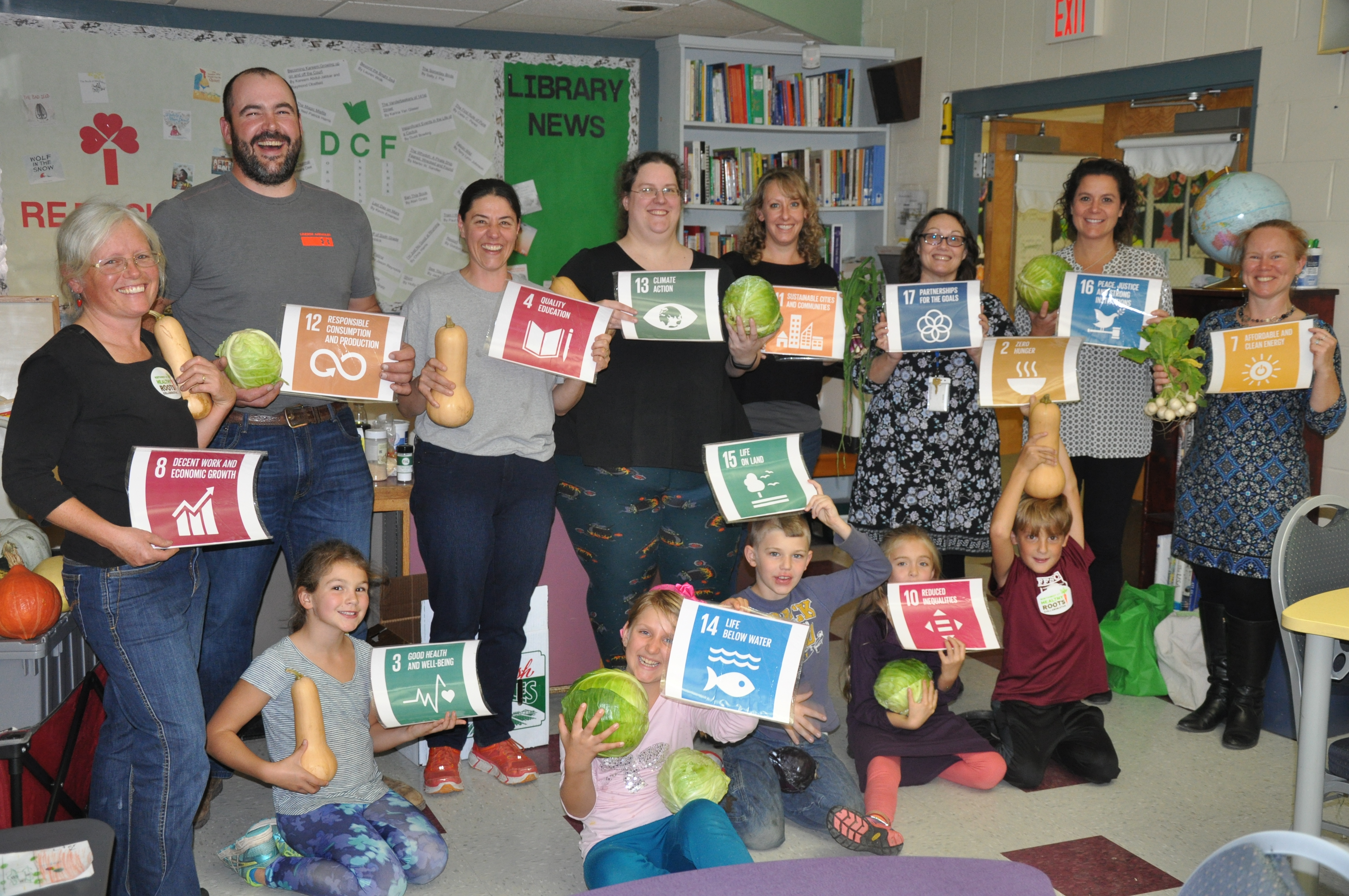 Parents and Students at Fletcher Elementary display the Global Goals