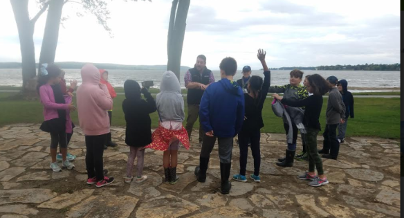 Students discuss their lake learning on the shores of Lake Champlain