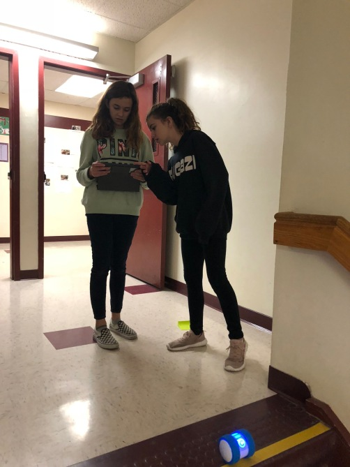 Two students collaborate on programming and coding in the classroom