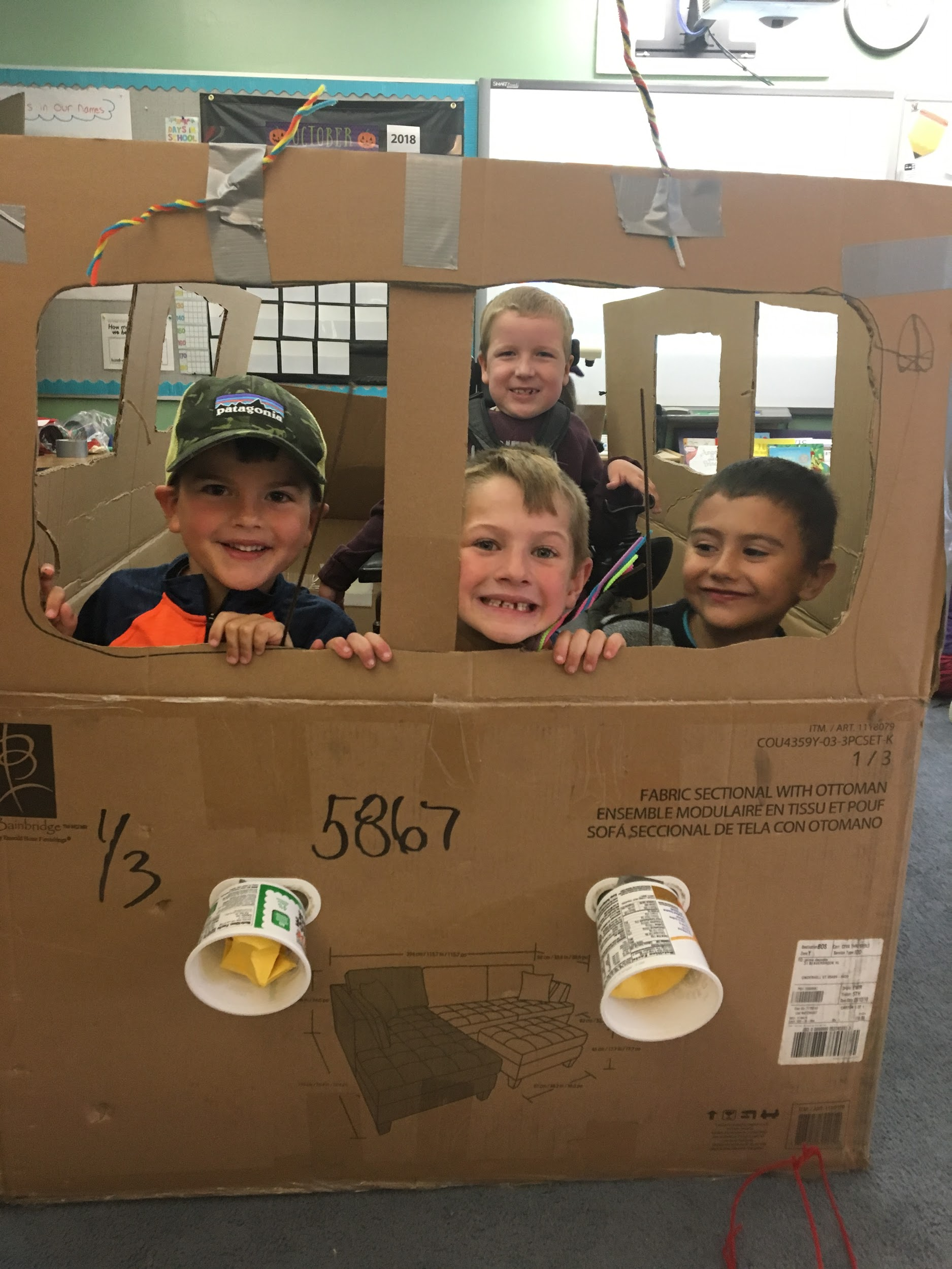 Students on the cardboard bus