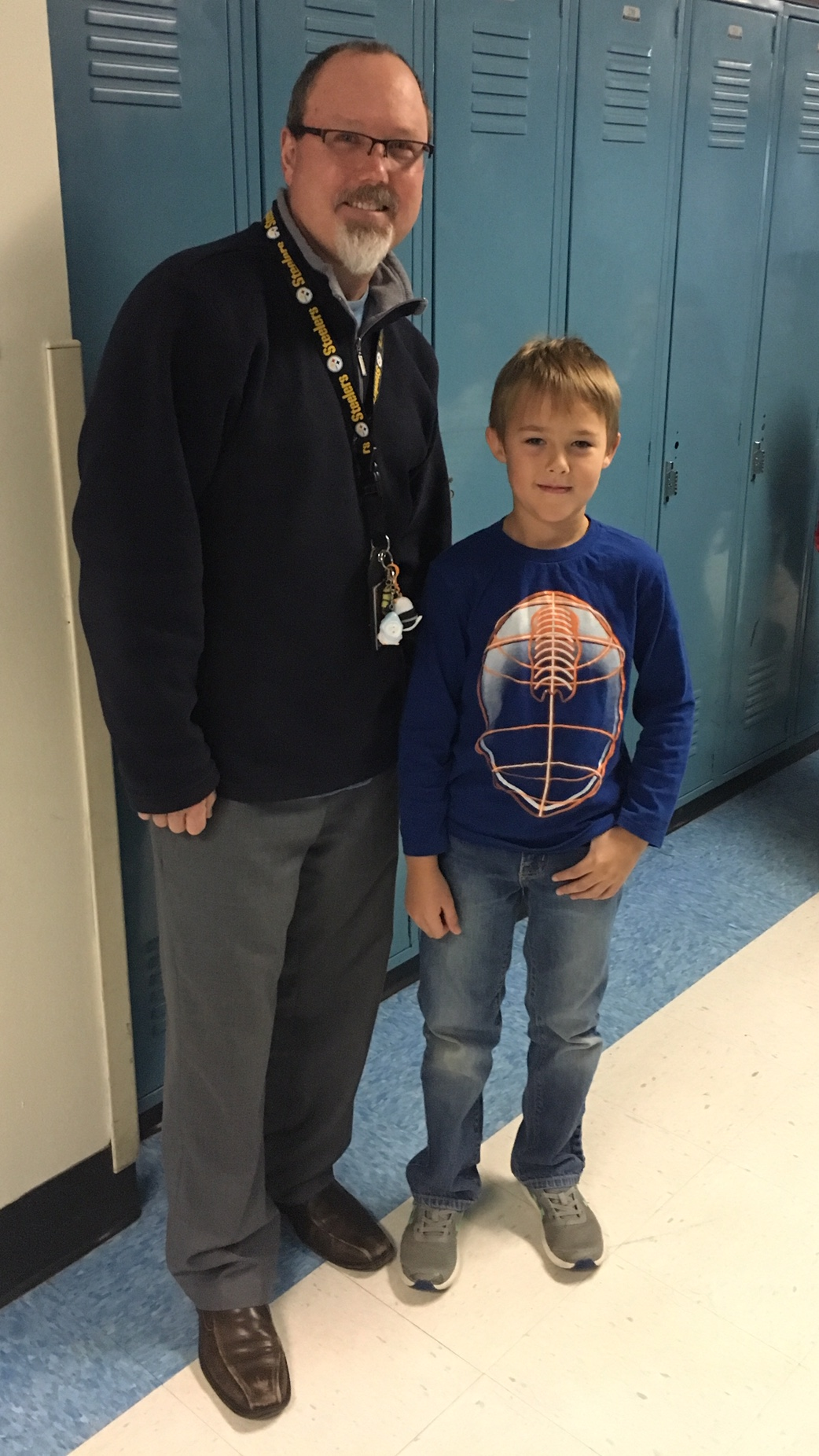 Georgia Elementary Principal Steve Emery smiles as student stands by