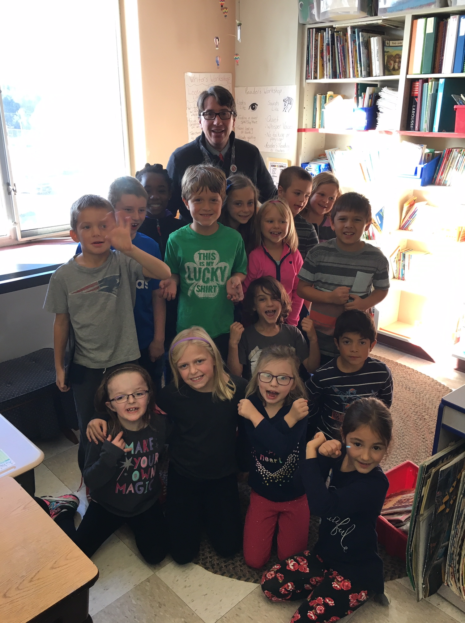 BFA Fairfax Elementary Principal Tom Walsh poses with classroom of students
